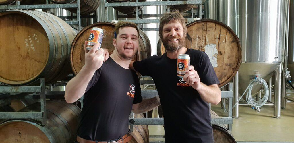 two blokes holding cans of Dainton Blood Orange NERIPA