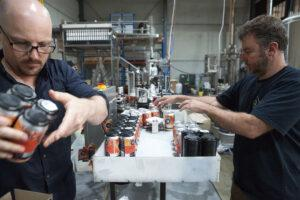 beer cans being labelled at Dainton Brewery & Taphouse